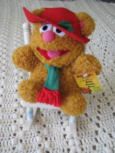 JIM HENSON'S PLUSH BABY FOZZIE BEAR SITTING ON A CERAMIC ROCKING CHAIR (Knoxville) for sale