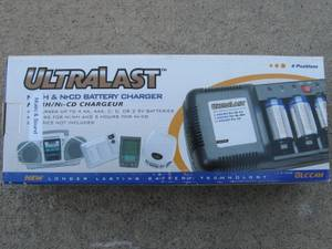 UltraLast ULCC4H Ni-MH and Ni-CD AA, AAA, C, D, 9v Battery Charger NEW, used for sale
