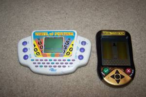 2 Handheld games - Wheel of Fortune and Deal or No Deal Handheld games (Ham Lake) for sale