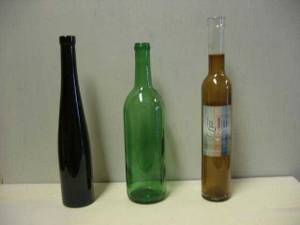 Used, wine bottles; flask; plastic barrel; cage; distill condenser (N. Burnaby) for sale