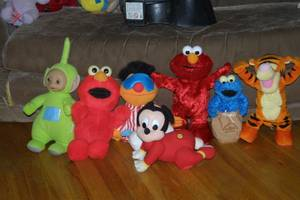 Blue Elmo Potatoe Sack Racer, Hokey Pokey Elmo, Tumbling Tigger, etc. (orange county) for sale